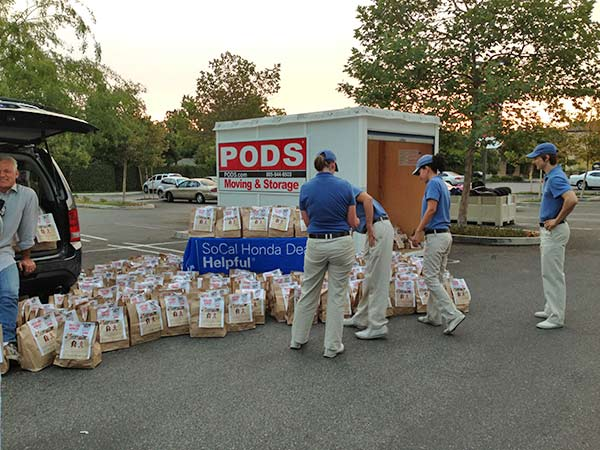 SoCal Honda Dealers representatives help sort donated bags of food at the Feed SoCal event in Thousand Oaks on Friday, July 19, 2013. <span class=meta>(KABC Photo)</span>