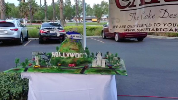 Sweet Art Cakes made a cake with a rotating AIR7 HD atop the Hollywood Hills. The company presented the cake at the Feed SoCal event in Ontario on Friday, July 26, 2013. <span class=meta>(KABC Photo)</span>