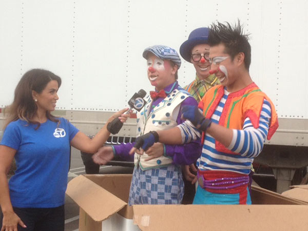 Clowns from the Ringling Bros. and Barnum &#38; Bailey Circus came out to support the Feed SoCal event in Costa Mesa on Friday, July 26, 2013. <span class=meta>(KABC Photo)</span>