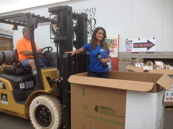 ABC7&#39;s Alysha Del Valle poses on a forklift at the Feed SoCal event in Costa Mesa on Friday, July 26, 2013. <span class=meta>(KABC Photo)</span>