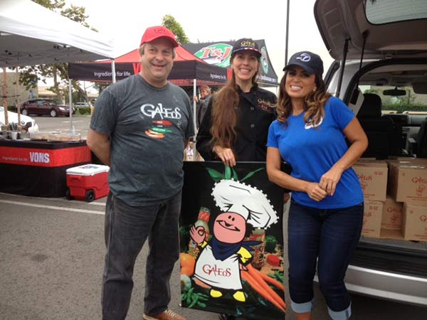 ABC7&#39;s Alysha Del Valle poses with Galeos representatives at the Feed SoCal event in Costa Mesa on Friday, July 26, 2013. <span class=meta>(KABC Photo)</span>
