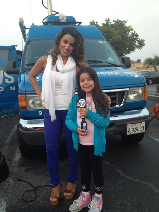 ABC7&#39;s Alysha Del Valle poses with a young fan, who came out to support the Feed SoCal event in Culver City on Friday, July 19, 2013. <span class=meta>(KABC Photo)</span>