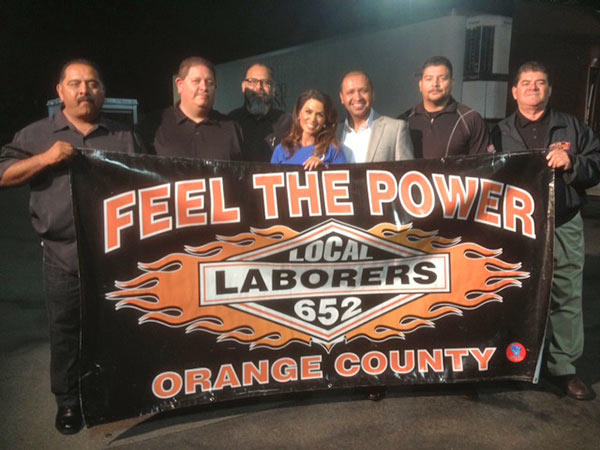 ABC7's Alysha Del Valle poses with members of Laborers Local 652 at the Feed SoCal