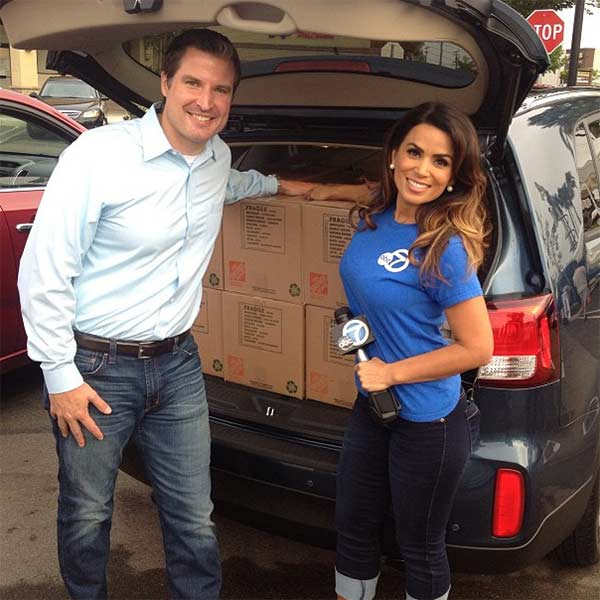 "<div class=""meta ""><span class=""caption-text "">ABC7's Alysha Del Valle poses with Scott, a Kia Motors representative, who donated a car full of food to the Feed SoCal event in Costa Mesa on Friday, July 26, 2013. (KABC Photo)</span></div>"