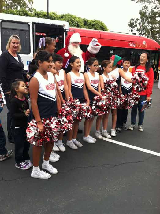Artesia High School cheerleaders pose with Santa Claus at the &#39;Spark of Love Toy Drive&#39; at Los Cerritos Center on Friday, Nov. 18, 2011. <span class=meta>(KABC Photo)</span>