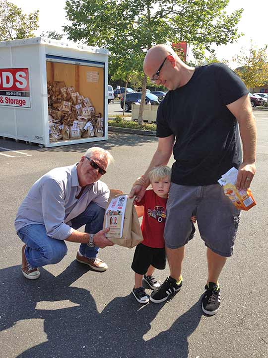 ABC7 Weathercaster Garth Kemp poses with Benjamin from Thousand Oaks, who donated food to the Feed SoCal event in Thousand Oaks on Friday, July 19, 2013. <span class=meta>(KABC Photo)</span>