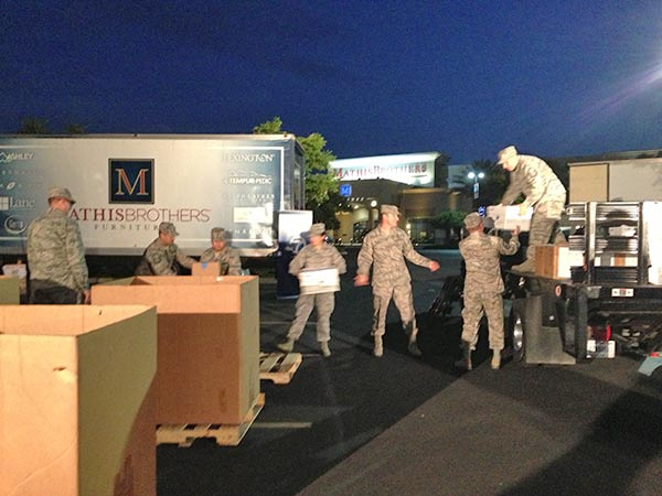 "<div class=""meta ""><span class=""caption-text "">Members of the California Air National Guard unload a car full of food donations at the Feed SoCal event in Ontario on Friday, July 26, 2013. (KABC Photo)</span></div>"