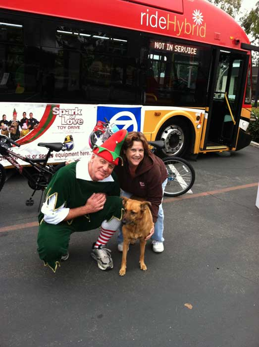 A family from Lakewood poses with Garf the Elf at the &#39;Spark of Love Toy Drive&#39; at Los Cerritos Center on Friday, Nov. 18, 2011. <span class=meta>(KABC Photo)</span>