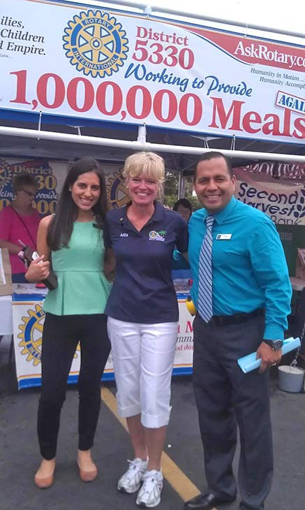 Anita, Rody and Mariella from Downey pose for a photo at the Feed SoCal food drive in Ontario on Friday, July 26, 2013. <span class=meta>(KABC Photo)</span>