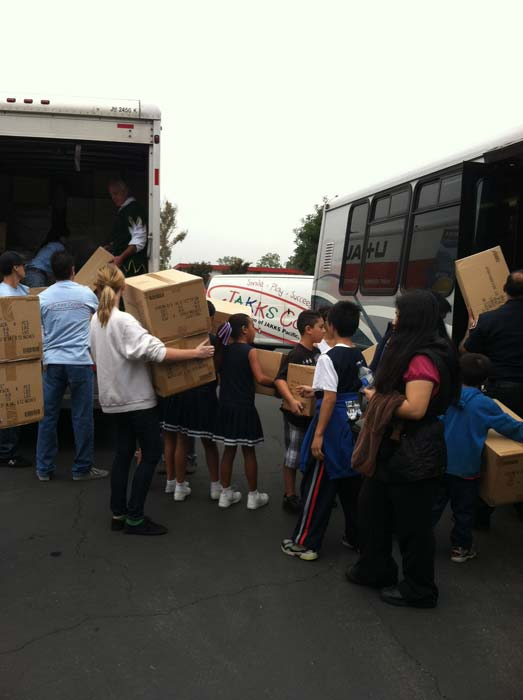 Busy elves unload toys brought by our friends of JAKKS at the &#39;Spark of Love Toy Drive&#39; at Los Cerritos Center on Friday, Nov. 18, 2011. <span class=meta>(KABC Photo)</span>