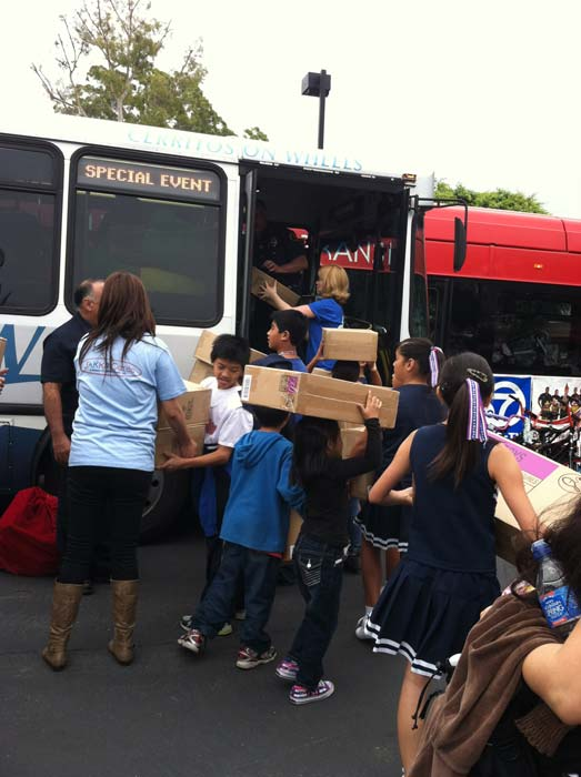 Busy elves load bus No. 2 with toys at the &#39;Spark of Love Toy Drive&#39; at Los Cerritos Center on Friday, Nov. 18, 2011. <span class=meta>(KABC Photo)</span>