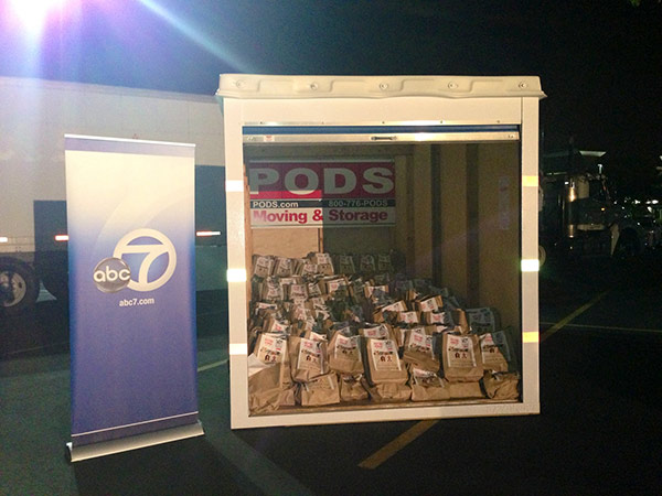 Bags of food are stacked inside a PODS&reg; container at the parking lot of Mathis Brothers Furniture in Ontario during the Feed SoCal event on Friday, July 26, 2013. <span class=meta>(KABC Photo)</span>