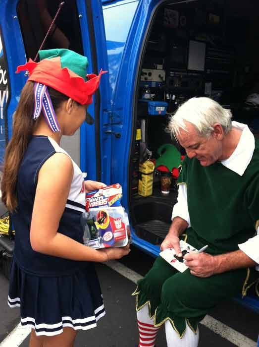 Garth the Elf signs an autograph from an adoring fan at the &#39;Spark of Love Toy Drive&#39; at Los Cerritos Center on Friday, Nov. 18, 2011. <span class=meta>(KABC Photo)</span>