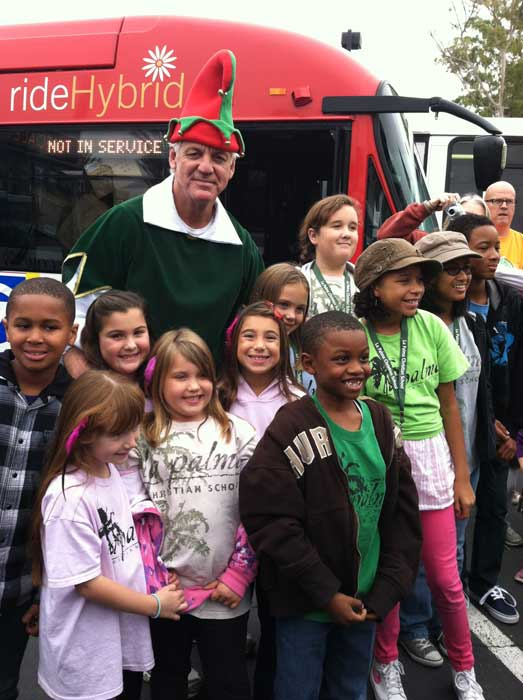 Garth the Elf poses with a group of kids at the &#39;Spark of Love Toy Drive&#39; at Los Cerritos Center on Friday, Nov. 18, 2011. <span class=meta>(KABC Photo)</span>