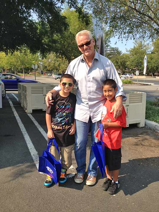 ABC7 Weathercaster Garth Kemp poses with Isacc and George from Thousand Oaks, who donated food to the Feed SoCal event in Thousand Oaks on Friday, July 19, 2013. <span class=meta>(KABC Photo)</span>