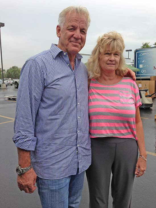 ABC7 Weathercaster Garth Kemp poses with Janet from Fontana, who came out to support the Feed SoCal food drive in Ontario on Friday, July 26, 2013. <span class=meta>(KABC Photo)</span>