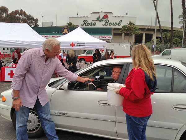 ABC7 Weathercaster Garth Kemp greets a donor who came out to the Rose Bowl in Pasadena to help the Red Cross raise funds for the victims of the Oklahoma tornado on Wednesday, May 22, 2013. <span class=meta>(KABC)</span>