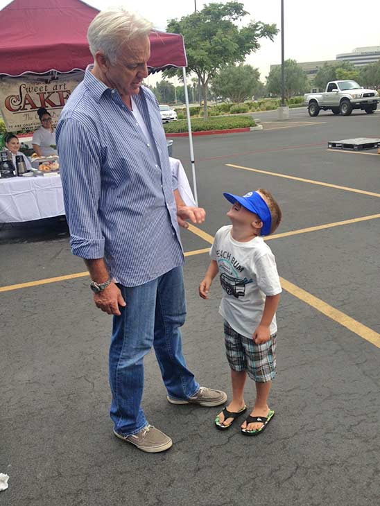 Five-year-old Hayden peers at ABC7 Weathercaster Garth Kemp through an oversized visor at the Feed SoCal event in Ontario on Friday, July 26, 2013. <span class=meta>(KABC Photo)</span>
