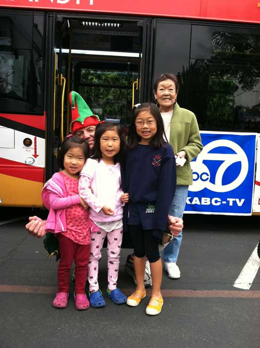 A family from Lakewood poses with Garth the elf at the &#39;Spark of Love Toy Drive&#39; at Los Cerritos Center on Friday, Nov. 18, 2011. <span class=meta>(KABC Photo)</span>