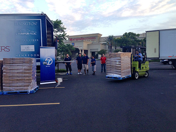 "<div class=""meta ""><span class=""caption-text "">Volunteers unload a truck full of food donations by Mathis Brothers Furniture at the Feed SoCal event in Ontario on Friday, July 26, 2013. (KABC Photo)</span></div>"
