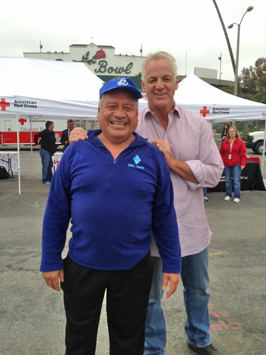 ABC7 Weathercaster Garth Kemp poses with a donor who came out to the Rose Bowl in Pasadena to help the Red Cross raise funds for the victims of the Oklahoma tornado on Wednesday, May 22, 2013. <span class=meta>(KABC)</span>
