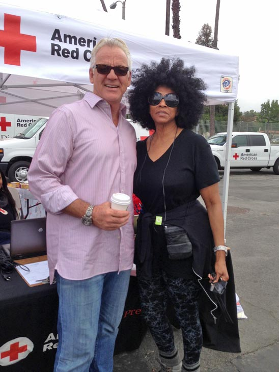 ABC7 Weathercaster Garth Kemp poses with ABC7 viewer Mae at a fundraising event at the Rose Bowl in Pasadena to help the victims of the Oklahoma tornado on Wednesday, May 22, 2013. <span class=meta>(KABC)</span>
