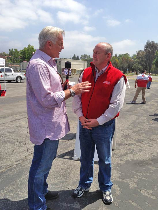 "<div class=""meta ""><span class=""caption-text "">ABC7 Weathercaster Garth Kemp speaks with Ben Green with the American Red Cross at a fundraising event at the Rose Bowl in Pasadena to help the victims of the Oklahoma tornado on Wednesday, May 22, 2013. (KABC)</span></div>"