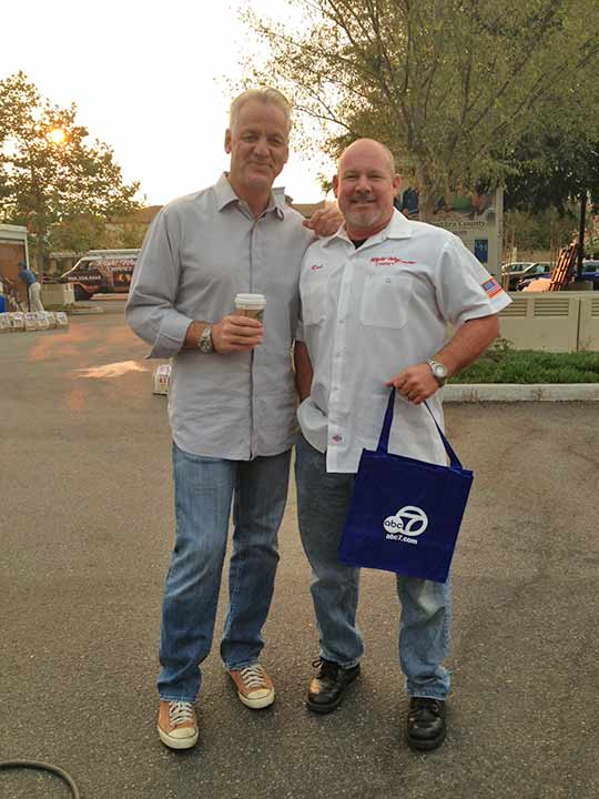 ABC7 Weathercaster Garth Kemp poses with Rich, who came out to support the Feed SoCal event in Thousand Oaks on Friday, July 19, 2013. <span class=meta>(KABC Photo)</span>