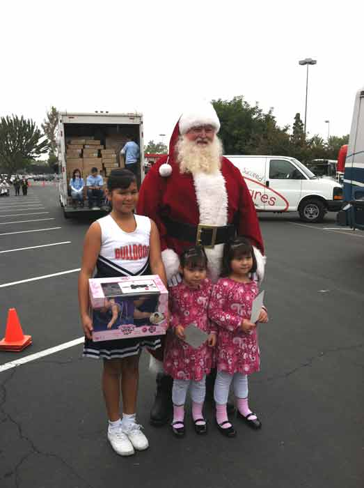 Santa Claus poses with three girls at the &#39;Spark of Love Toy Drive&#39; at Los Cerritos Center on Friday, Nov. 18, 2011. <span class=meta>(KABC Photo)</span>