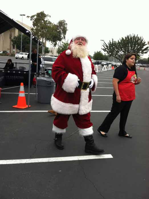 "<div class=""meta ""><span class=""caption-text "">Santa Claus arrives at the 'Spark of Love Toy Drive' at Los Cerritos Center on Friday, Nov. 18, 2011. (KABC Photo)</span></div>"