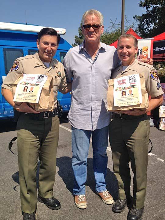 ABC7 Weathercaster Garth Kemp poses with Captain Aguilar and Senior Deputy Lohman with the Ventura County Sheriff&#39;s Department at the Feed SoCal event in Thousand Oaks on Friday, July 19, 2013. <span class=meta>(KABC Photo)</span>