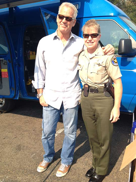 ABC7 Weathercaster Garth Kemp poses with Captain Monica McGrath with the Ventura County Sheriff&#39;s Department at the Feed SoCal event in Thousand Oaks on Friday, July 19, 2013. <span class=meta>(KABC Photo)</span>