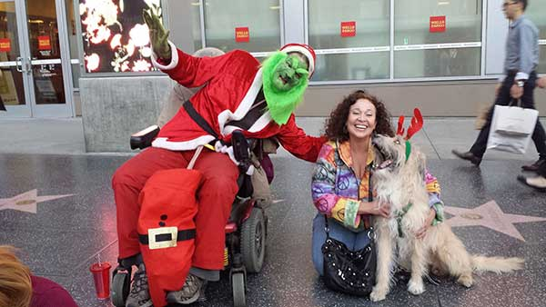 "<div class=""meta image-caption""><div class=""origin-logo origin-image ""><span></span></div><span class=""caption-text"">Elaine and Choi at the Hollywood Christmas parade say ""Merry Grinch-mas!"" Use #ABC7HomeForTheHolidays on Facebook, Twitter and Instagram to share your holiday photos with ABC7. We'll feature some of the best on our newscasts and here on abc7.com! (KABC)</span></div>"