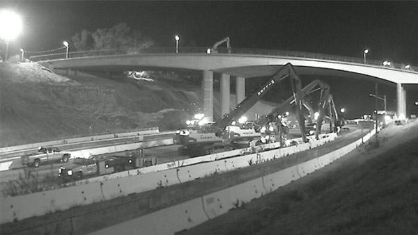 Construction crews begin work on taking apart  the south side of the Mulholland Bridge after the 405 Freeway  closed at midnight on July 16, 2011.