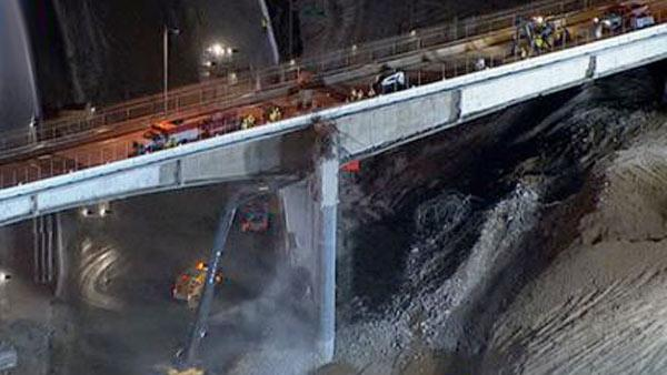 Crews continue to work on the Mulholland Bridge Saturday night to stay on schedule for the 405 Freeway project.