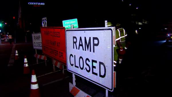 Signs indicate ramp closures for the 405 Freeway on Friday, Sept. 28, 2012.