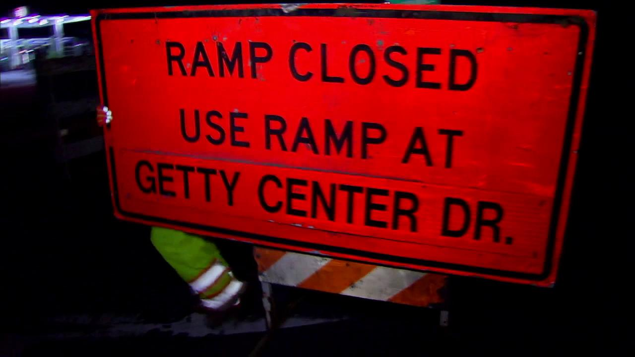 A worker places a ramp closed sign at an onramp for the 405 Freeway on Friday, Sept. 28, 2012.