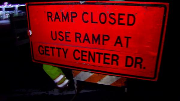 A worker places a 'ramp closed' sign at an onramp for the 405 Freeway on Friday, Sept. 28, 2012.