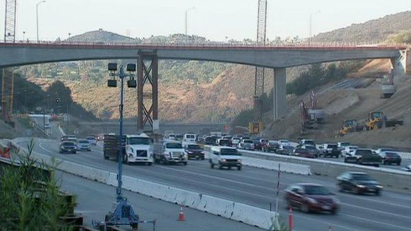 Commuters drive under the Mulholland Drive Bridge on Monday, Oct. 1, 2012, after the 405 Freeway reopened.