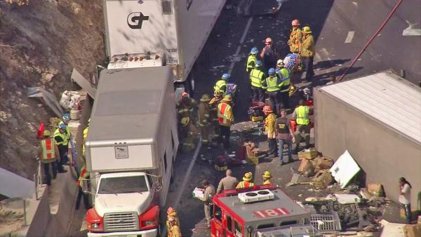 Rescuers respond to the scene of a major accident on the eastbound 60 Freeway in Diamond Bar on Friday, Oct. 19, 2012.