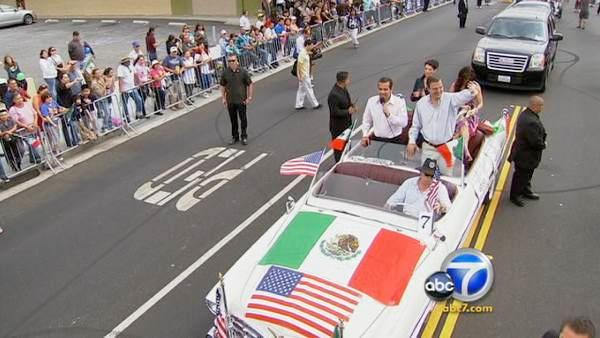 Los Angeles Mayor Antonio Villaraigosa and Mexico City Mayor Marcelo Ebrard greet parade goers at the 65th annual Mexican Independence Day Parade in East Los Angeles on Saturday, Se