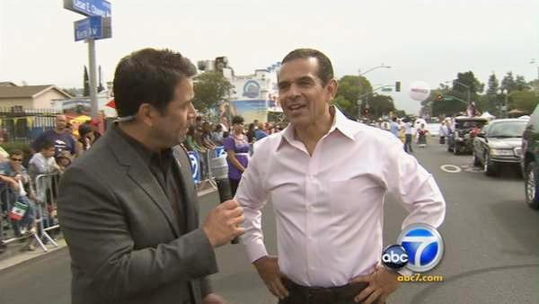 Los Angeles Mayor Antonio Villaraigosa speaks with Eyewitness News reporter Robert Holguin during the 65th annual Mexican Independence Day Parade in East Los Angeles on Saturday, Sept. 10, 2011.