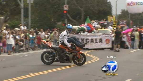 Performer Aaron Colton, sponsored by Red Bull, showcases his motorcycle skills during the 65th annual Mexican Independence Day Parade in East Los Angeles on Saturday, Sept. 10, 2011.