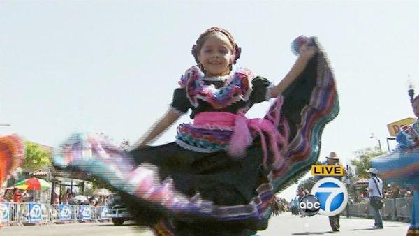 A young girl dances during the Mexican Independence Day Parade on Sunday, Sept. 9, 2012.