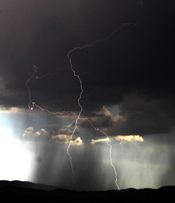 From ABC7 viewer Gene Blevins, lightning bolts seen from Highway 247 on Aug. 25, 2010. &#160;When you see breaking news happen, send your photos to video@myabc7.com, or send them to @abc7 on Twitter <span class=meta>(ABC7 viewer Gene Blevins)</span>