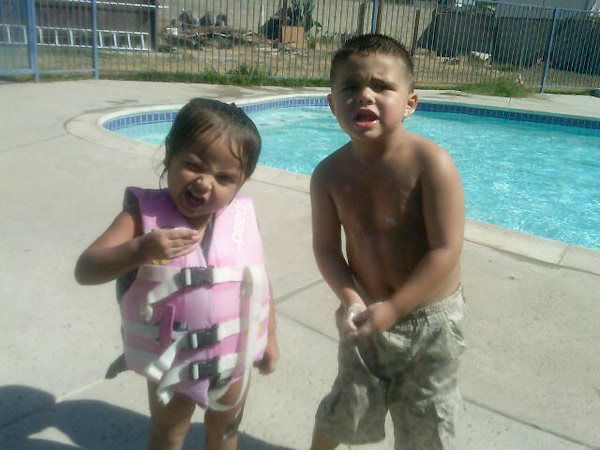 Anaiia and her cousin Orlando stay cool by...