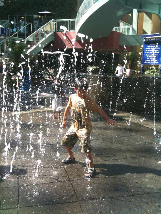 This young ABC7 viewer stays cool by playing in the water at Universal City Walk on Monday, Sept. 27, 2010. &#160;Submit your &#39;hot shots&#39; to  Eyewitness News, or send them to video@myabc7.com. <span class=meta>(Christina Palioungas)</span>