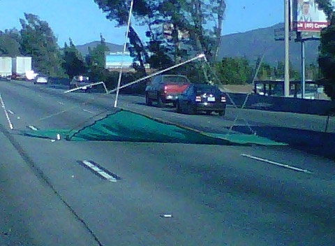 ABC7 viewer Annie Blanco sent in this photo of a tent that flew onto Interstate 10 in Rancho Cucamonga on Thursday, Nov. 11, 2010.  When You Witness breaking news, or even something extraordinary, send pictures and video to video@myabc7.com, or send them to @abc7 on Twitter <span class=meta>(ABC7 viewer Annie Blanco)</span>