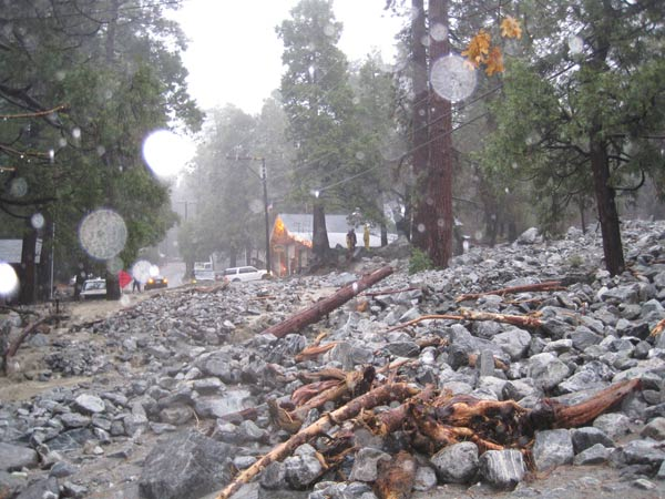 An ABC7 viewer sent in this photo of a blocked road from a the wild winter storm on Monday, Dec. 20, 2010. &#39;Valley of the Falls Drive in Forest Falls, San Bernardino County, is washed out with mud, boulders and trees for about a half mile.  People are stranded with no way up or down the mountain.&#39;   When You Witness breaking news, or even something extraordinary, send pictures and video to video@myabc7.com, or send them to @abc7 on Twitter <span class=meta>(ABC7 viewer)</span>
