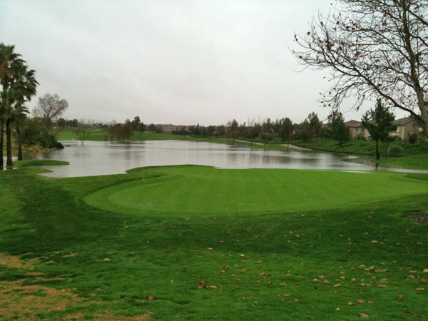 ABC7 viewer Chris Hinojosa sent in this photo of the 14th hole flooded at Sierra Lakes Golf Course on Tuesday, Dec. 21, 2010.   When You Witness breaking news, or even something extraordinary, send pictures and video to video@myabc7.com, or send them to @abc7 on Twitter <span class=meta>(ABC7 viewer Chris Hinojosa)</span>